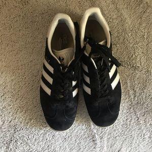 Black Gillette adidas sneakers